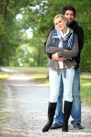 25 to 30: Couple hugging on a forest path