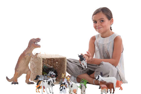 horse stable: little girl with animal figurines