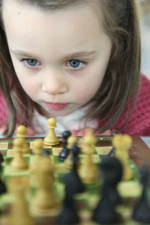 Little girl playing chess Stock Photo - 11843456