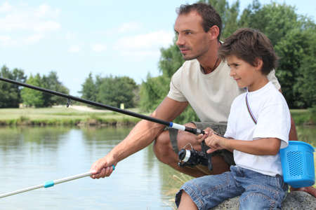 family outing: Father and son fishing Stock Photo