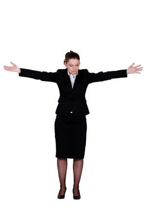 arms wide: Businesswoman with her arms spread out