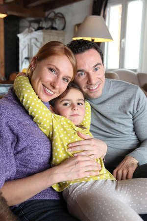 Young family sat on couch Stock Photo - 11843802