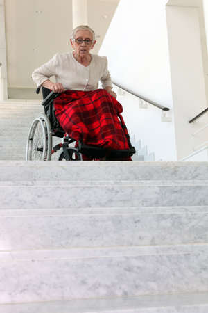 old woman in wheelchair photo