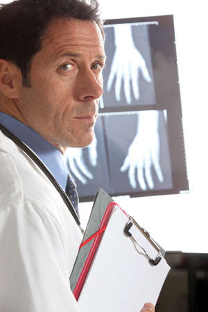electromagnetic radiation: Doctor looking at an x-ray