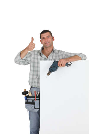 Thumbs up from a builder with a blank board photo