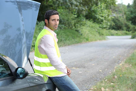 roadside assistance: Man waiting for roadside assistance Stock Photo