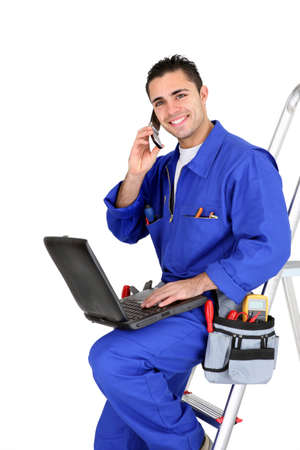 Electrician with a phone and laptop photo