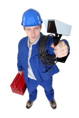 Tradesman holding a surveillance camera Stock Photo - 11843096