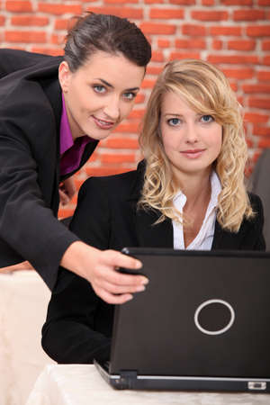 Businesswomen on laptop photo