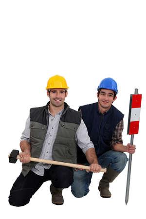 industrious: duo of workman posing in studio