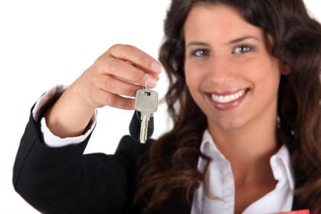 only one woman: Female estate-agent handing over keys Stock Photo