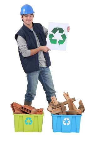 young bricklayer holding recycling logo Stock Photo - 11912534