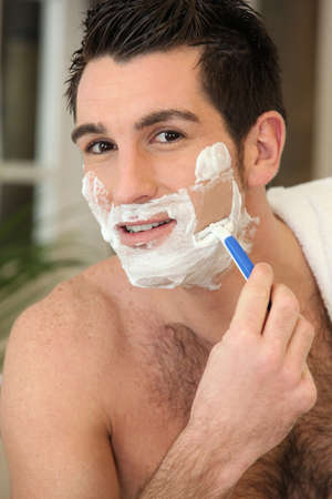 Man shaving his face photo