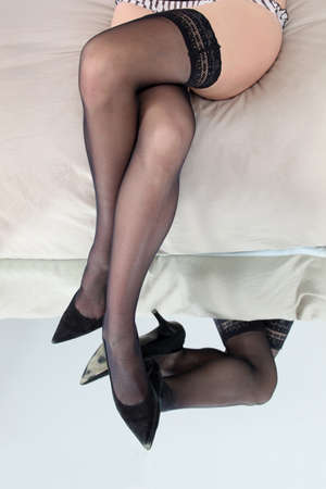 fine legs: Stocking clad legs reflected in a mirror