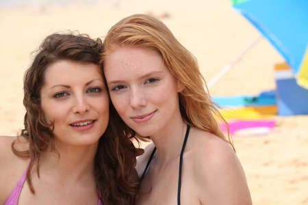 redhead: Two young women on a sandy beach