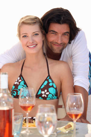 couple relaxing in a beach restaurant photo