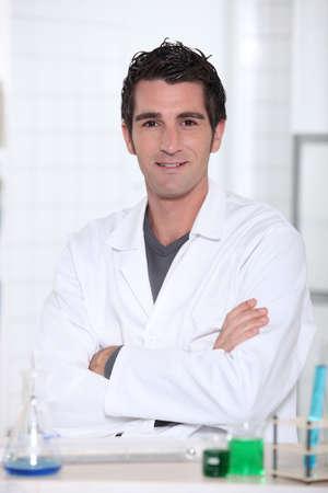 chemistry lesson: Man wearing lab coat Stock Photo