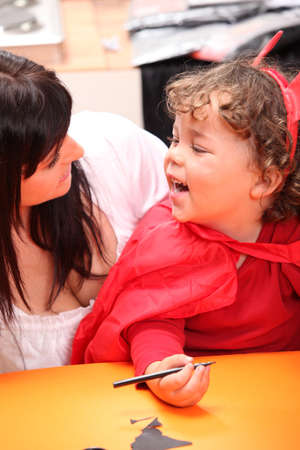 make belief: Mother sharing a moment with her daughter on Halloween
