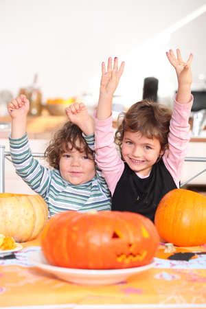 Children carving pumpkins photo