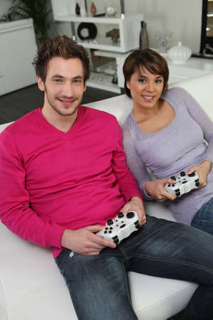 gamers: Young couple of gamers