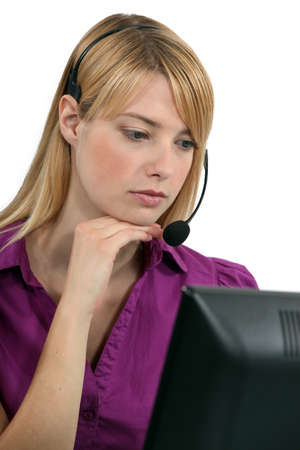 poker faced: A serious receptionist wearing a headset