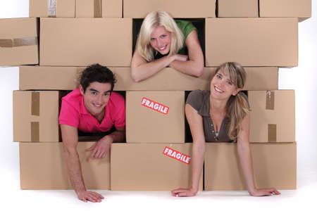 out of the box: Friends moving out. Stock Photo