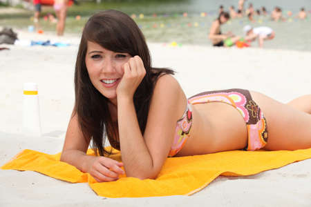 two piece swimsuit: brunette basking in the sun