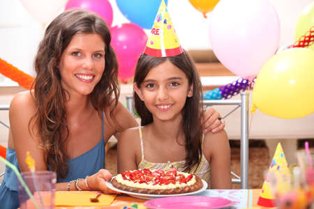 portrait of mother and daughter at birthday party photo