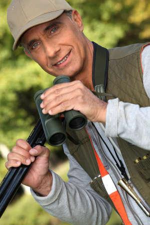 45 ammo: Hunter with his binoculars