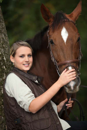 Young woman with her horse photo