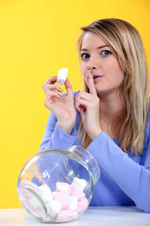 desirous: Woman eating marshmallow