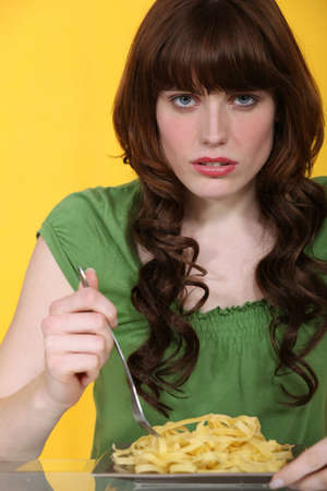 boring: Woman eating plain tagliatelle