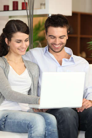 websurfing: Couple using a laptop at home