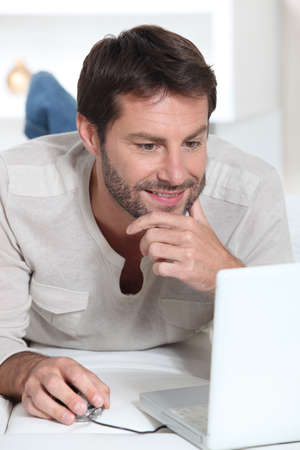 40 45: Man on laptop Stock Photo