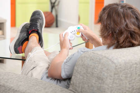 A teenager playing a video game Stock Photo - 11912886
