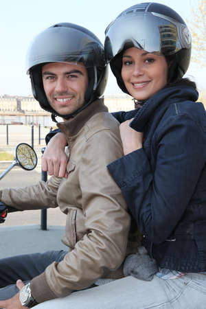 Couple riding a motorcycle photo