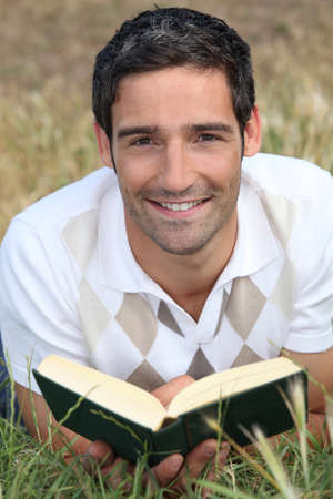 stubble: Man reading on the grass