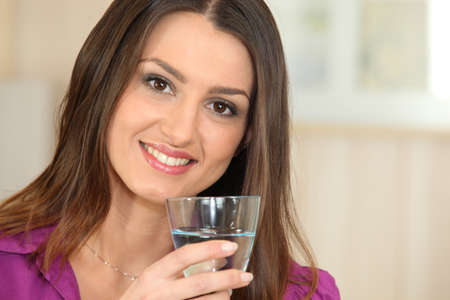 30 35 years women: Woman drinking a glass of water