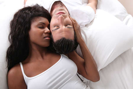 Couple tenderly embraced in bed photo