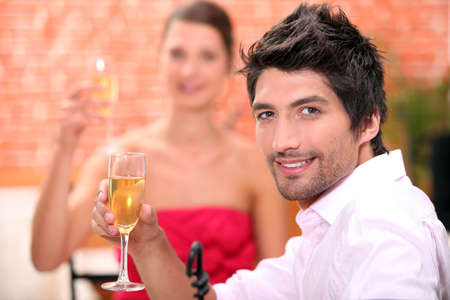 Couple on a date drinking champagne. photo