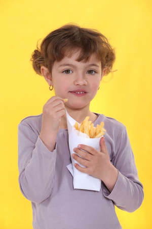 Girl eating a bag of chips photo