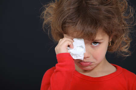 sore eye: Crying little girl Stock Photo