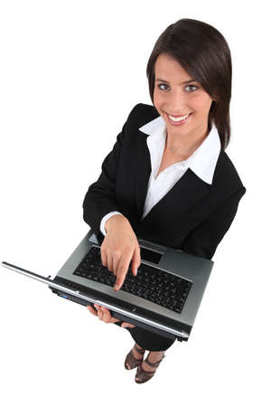 Brunette woman with computer photo