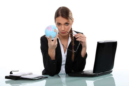 Office worker holding globe photo