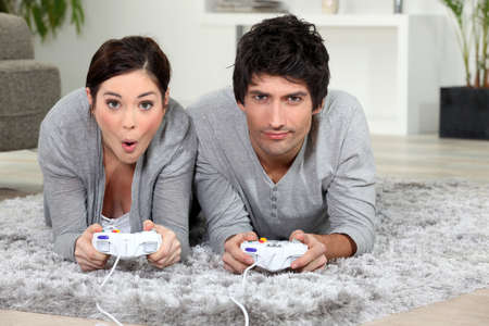 Couple playing video game. photo