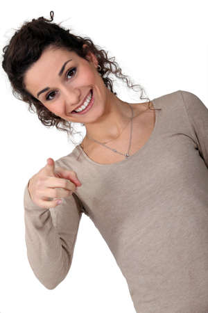 chuckle: Woman giggling and pointing