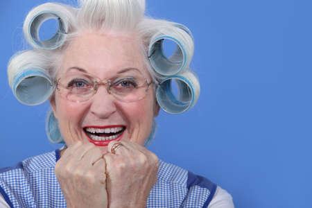 hair curler: senior woman with curlers in her hair laughing