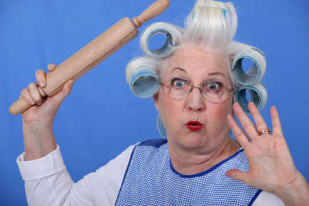 Scared old lady with hair rollers photo