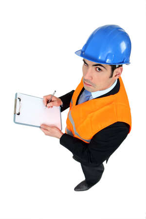 engineering clipboard: Man inspecting a premises