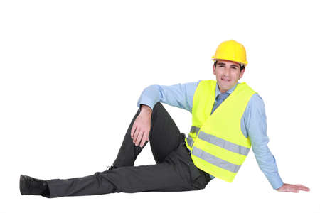 Engineer sitting on the ground photo